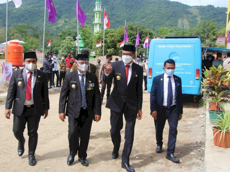 Gubernur Sulsel Nurdin Abdullah saat hendak meresmikan Anjungan Sungai Mata Allo.